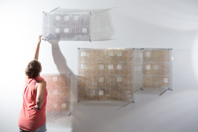 Artist Lauren Bierly installs her PRIME exhibit