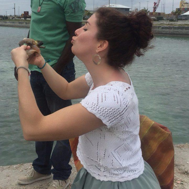 Aubrie kisses the conch
