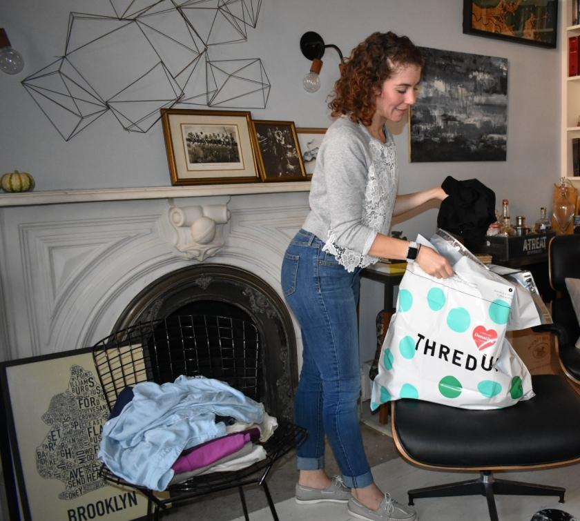 Aubrie packs a bag for thredUP